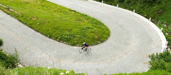 Brevet's challenging cycling holidays include the Granfondo Gottardo which features the highest cobbled road in Europe | Brevet Alpine Cycling Adventures