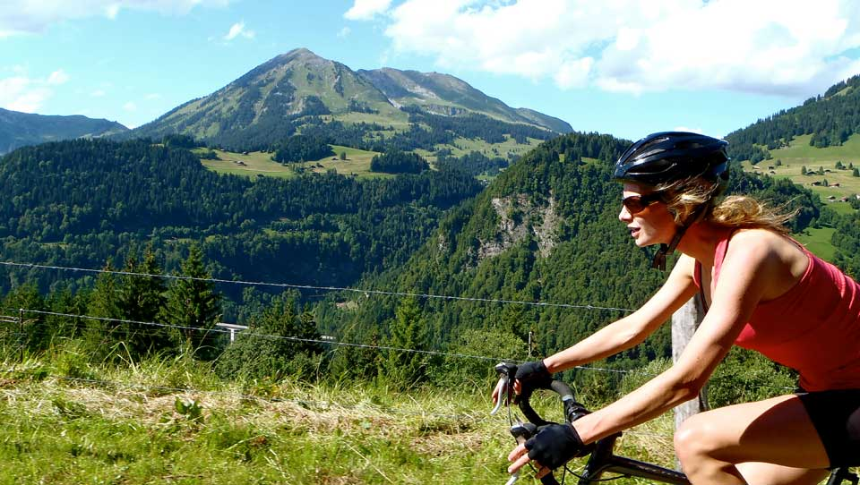 Charlotte climbing the Côte de la Forclaz: Cycling in the Alps is challenging but with our unique professional cycling support you can surpass your expectations on a Brevet cycling holiday