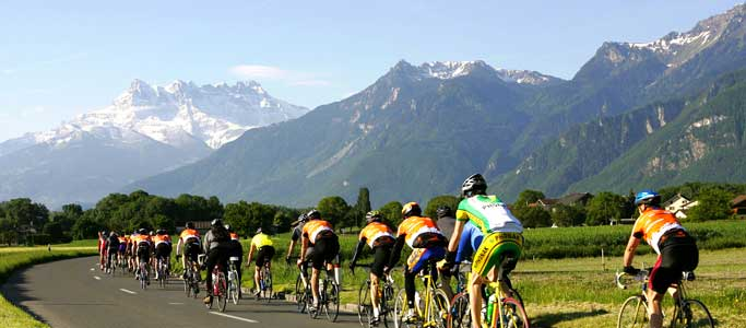 Riders approach the Dents du Midi in the Cyclotour du Léman